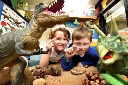 Dinosaur discoveries and adventures at Lythe School. Summer and Logan investigate. pic Richard Ponter.
