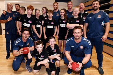 The Wigan Dodgeball Warriors and Wigan Warriors sides which faced off on the dodgeball court as part of a fund-raising night to get the young players to their sports World Cup in Egypt