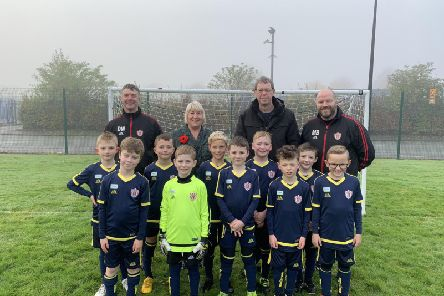 Hawkley Hall FC sporting their new strip with councillors Marie Morgan and Paul Kenny