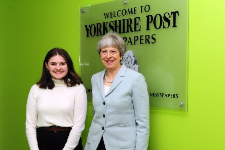 Prime Minister Theresa May with Apprentice Natasha Meek at Yorkshire Post Newspapers in February 2018.