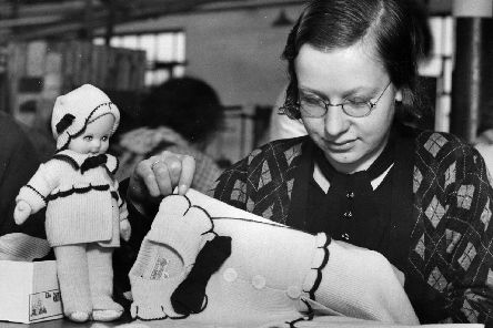 13th March 1934:  A worker finishing off a woollen suit at the Windsor factory at Blackpool. The Duchess of York ordered the clothing worn by the woolly Windsor doll for Princess Margaret Rose