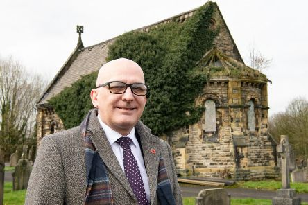 Coun Terry Halliwell outside one of the dilapidated chapels