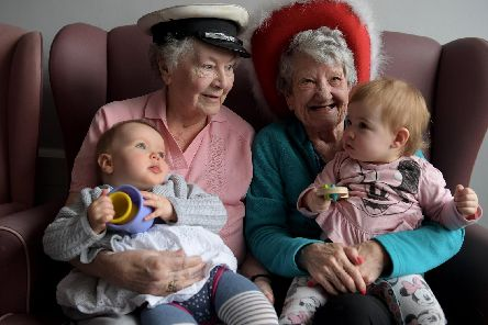 Children meet Appleby Court residents for an intergenerational cuddle hour.