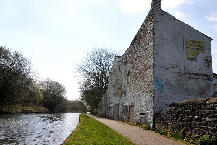 The ugly buildings on the banks of the canal at Poolstock