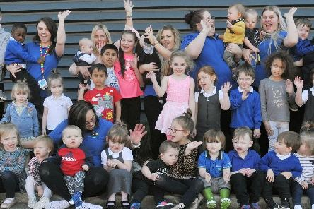 Staff and youngsters at The Wendy House celebrate
