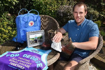 Sam Robinson prepares his gear for the walk up Helvelyn to raise money for research into Crohns disease following the death of his brother George