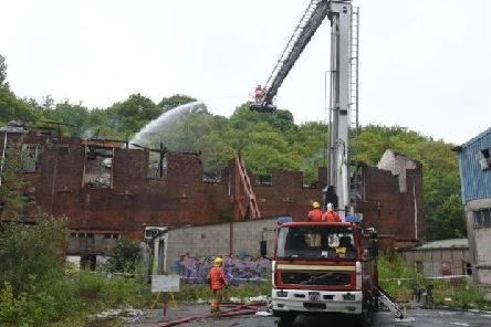Firefighters at the scene following the initial blaze