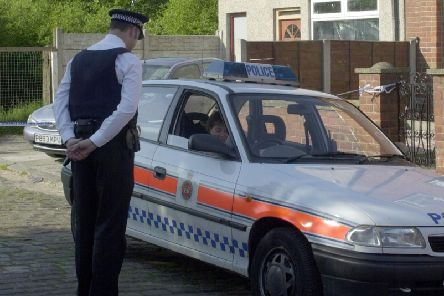 Police outside the scene of the crime in 2001