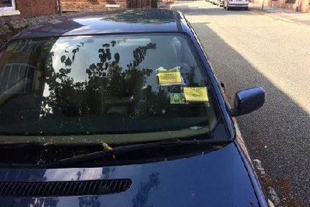 A vehicle with several parking fines on Acton Street