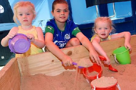 Youngsters enjoying the sand pit