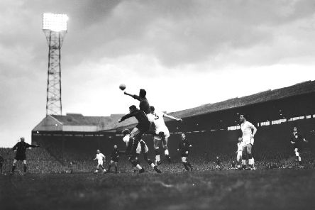 Harry Gregg punches a ball clear against AC Milan in the first leg of the European Cup semi-finals at Old Trafford, in May 1958. United won the match 2-1. (all photos: Getty Images)