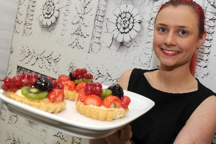 Supervisor Zoe Calder holds up some fruit tarts at Caffe Massarella, Meadowhall. Picture: Andrew Roe