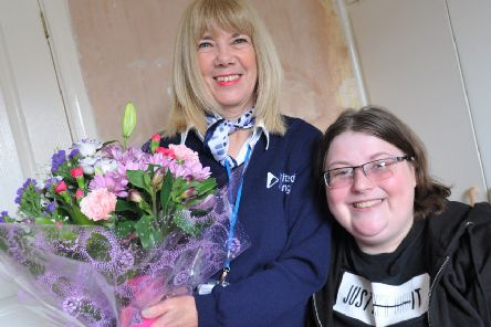 Lifesaver Vanessa Welch is presented with a bouquet of flowers by grateful tenant Amanda Sheehan (right).