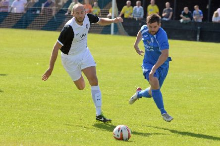 Armthorpe Welfare v Worksop Town. Worksop's Matthew Booth and Armthorpe's Stuart Preston. Picture: Marie Caley NDFP 09-08-14 Armthorpe v Worksop MC 3