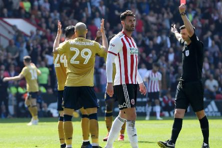 SHEFFIELD, ENGLAND - APRIL 19: Yohan Benalouane of Nottingham Forest is shown a red card by referee Andrew Madley during the Sky Bet Championship match between Sheffield United and Nottingham Forest at Bramall Lane on April 19, 2019 in Sheffield, England. (Photo by Ross Kinnaird/Getty Images)