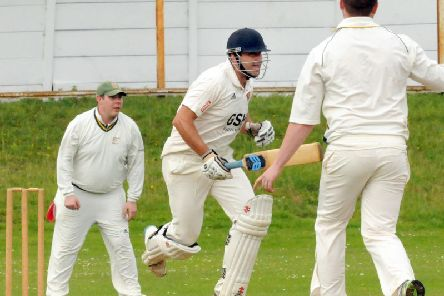 Killamarsh's Adam Burgess puts runs on the board against Worksop.