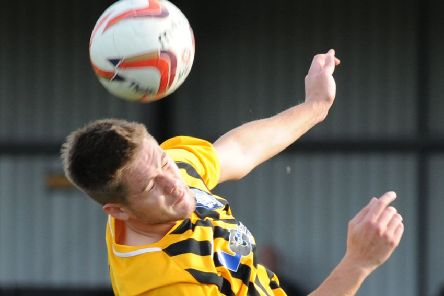 Worksop Town FC Maltby Main.  'Max Pemberton gets head and shoulder above Jonathan Hill.