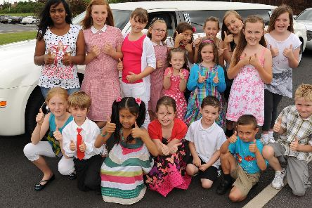 2010: A fantastic group shot of pupils from Holy Family School being treated to a ride in a limousine to McDonalds for having an 100 per cent attendance record, courtesy of Stretch 2 Extreme limo service. Are you on this picture?