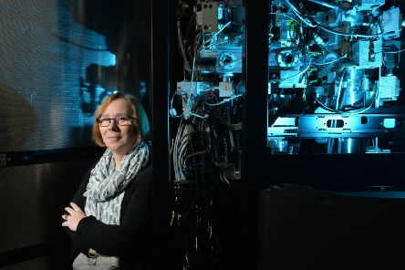 Professor Sheena Radford with the electron microscope recently bought by the University in order to further research like hers.