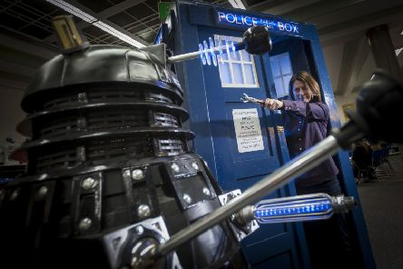 DOCTOR IN THE HOUSE: Huddersfield Literature Festival director Michelle Hodgson gets close up and personal with a Dalek at the preview. PIC: Jonathan Jacob