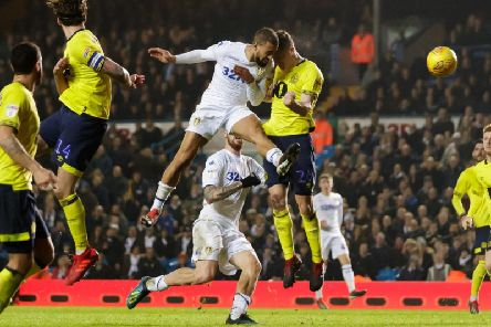 Kemar Roofe heads home a dramatic 95th-minute winner in Leeds United's 3-2 victory over Blackburn Rovers on Boxing Day.