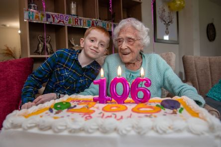 Monica Budge, who lives at at her retirement community at Assisi Place in Hunslet, Leeds, celebrating her 106th birthday with her great grandson Samuel Barrett, aged eight, of Garforth. Picture by James Hardisty.