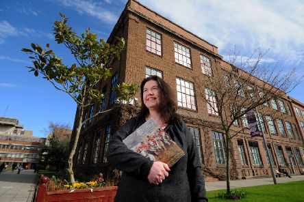 Dr Catherine Wynne pictured with her book at Hull University.