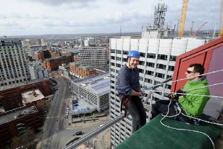 Ben White gets ready to abseil down the CVL building in Leeds earlier today.
