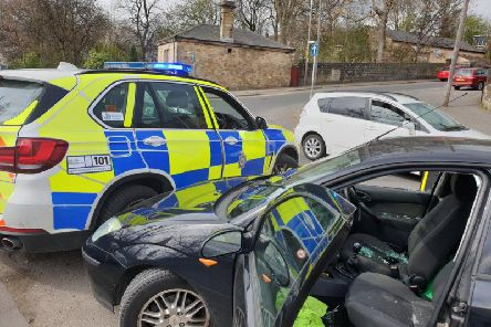 A car thief who wanted for three burglaries tried to ram these police 4x4s on a Yorkshire road. Photo credit: @WYP_TrafficDave West Yorkshire Police.