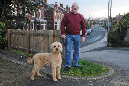 Tam Fulton at home in Beeston with his dog George.