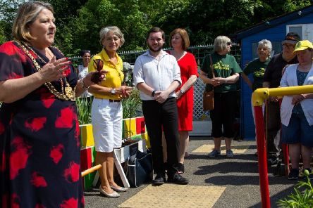 PARTY:  Coun Jane Dowson speaking at The Growing Zone's 10th anniversary celebrations with chairwoman June  Perkin,  second left.