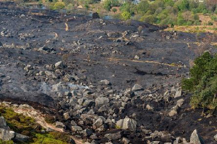 Firefighters continue to damp down following a moorland fire on Ilkley Moor. It came as crews battled a much larger blaze on Marsden Moor - caused by a barbecue.