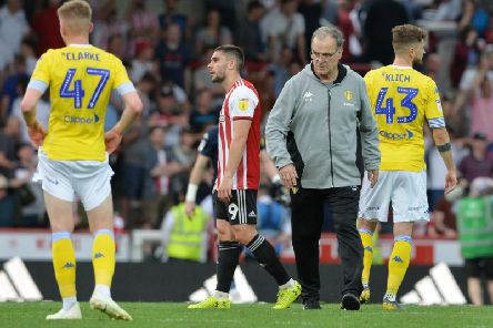 Leeds United head coach greets his players at full-time following Brentford defeat.