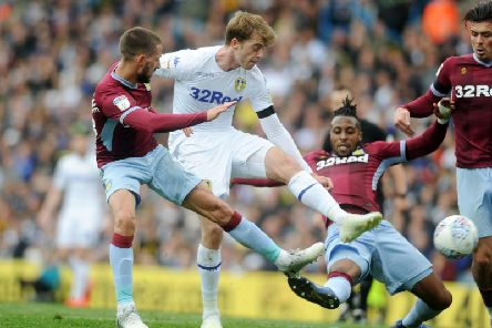 SPICY: Tackles flew in between Leeds United and Aston Villa with Patrick Bamford challenging Jonathan Kodjia.
