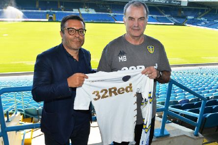 Leeds United owner Andrea Radrizzani (L) and head coach Marcelo Bielsa (R).