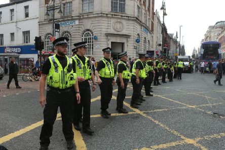 Police officers at a protest in Leeds city centre in 2018. Picture: SWNS