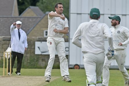 James  Davies jumps for joy after taking the wicket of Toby Jacklin LBW for 0. He took the first three Collingham & Linton wickets in a 141-run win for league leaders Otley. PIC: Steve Riding
