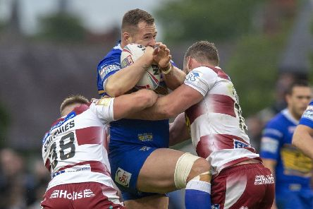Trent Merrin taking the game to Wigan Warriors. PIC: Bruce Rollinson