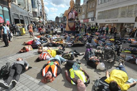 Extinction Rebellion protesters staging a mass 'die-in' on Briggate.
