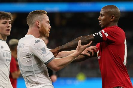 LATE CHECK: On Adam Forshaw, left, after a rash challenge from Manchester United's Ashley Young, right, in Wednesday's friendly. Photo by Paul Kane/Getty Images.