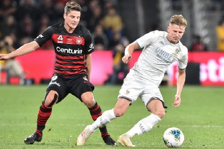 NEW STAR: Leeds United's Mateusz Bogusz fights for the ball with Permin Schwegler of Western Sydney Wanderers. Photo by Peter Parks/AFP/Getty Images.