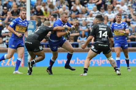 Leeds Rhinos' Brad Singleton runs at Hull's Sika Manu and Jake Connor. (Picture: Tony Johnson)