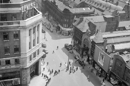 Rooftop view of the Headrow in Leeds City Centre. Lewis's shop in the foreground, left and Schofields on the right.. Possibly from 1953, as there is a prominent picture of Queen Elizabeth II in front of Schofield's department store.