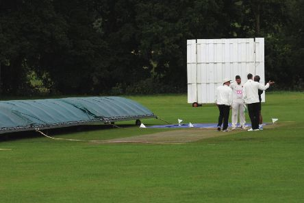 Umpires and captains discuss the pitch before calling off the game between Division 3 rivals Bardsey and Hall Park. PIC: Steve Riding