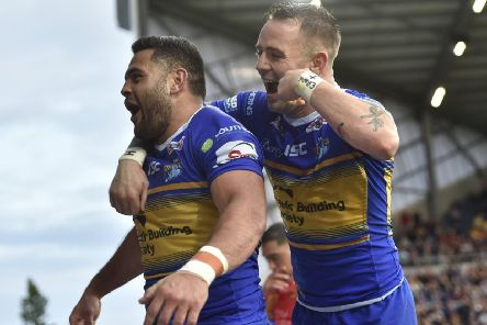 Rhyse Martin celebrates his try agianst Catalans Dragons with Richie Myler.