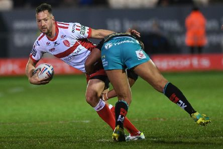 Hull KR's Danny McGuire in action against Leeds Rhinos.