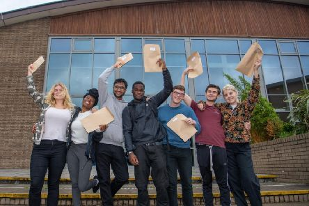 Students at Abbey Grange Church of England Academy,  Butcher Hill, Leeds, celebrating their A Level results. Pictured are Erin Kershaw-Smith, Haja Kamara, Hishaam Maqsood-Shah, Joseph Aggrey, Tom Elton, Alex Clark, and Danni Banks.