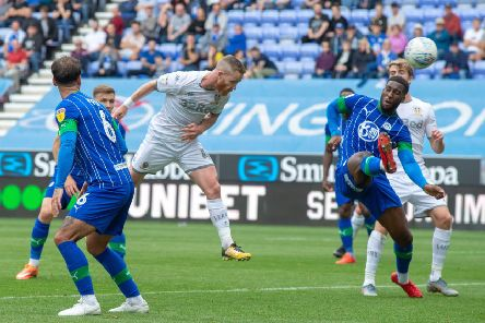 Adam Forshaw fires a header towards the WIgan goal - Patrick Bamford was on hand to convert the rebound.