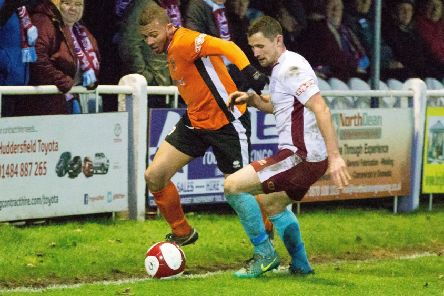 Guiseley's Aaron Martin in action for Brighouse Town.
