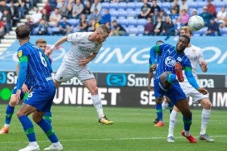 SO CLOSE: Leeds United midfielder Adam Forshaw thumps a header against the post in Saturday's 2-0 win at Wigan Athletic, setting up the opening goal for Patrick Bamford as a result. Picture by Bruce Rollinson.